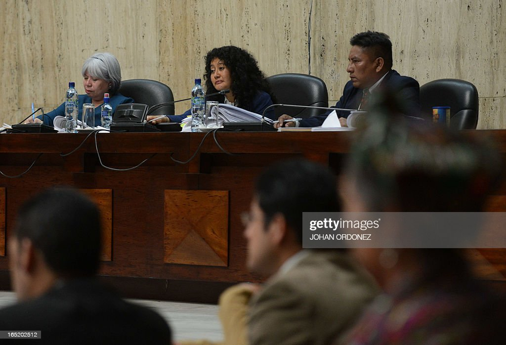 Judge Jasmin Barrios (C) is seen at court room where Former Guatemalan dictator (1982-1983), retired General Jose Efrain Rios Montt(R), 86, is judged on charges of genocide, in Guatemala City on April 1, 2013. Rios Montt, who stands trial despite defense attempts to postpone the start of the historic proceedings, is accused of ordering the execution of 1,771 members of the indigenous Ixil Maya people in the Quiche region. Rios Montt refrained from testifying. AFP PHOTO/Johan ORDONEZ