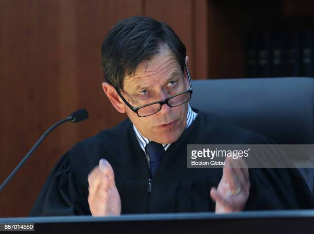 Judge Jeffrey Locke asks a question of a witness during the trial of three prison guards facing manslaughter charges in the 2009 death of a 23yearold...