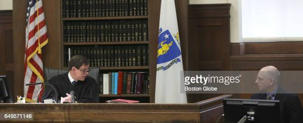 Judge Jeffrey Locke asks Sergeant Detective Daniel Duff a question during testimony at former New England Patriots tight end Aaron Hernandez's double...