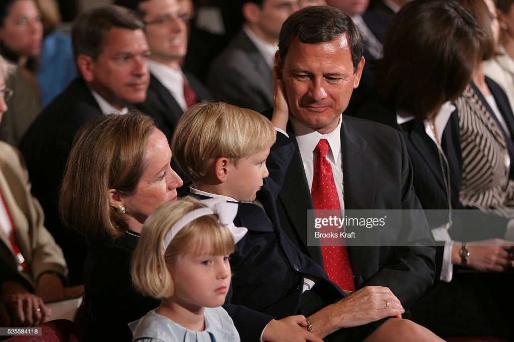 Judge John Roberts nominated by US President George W Bush to be Chief Justice of the US sits with his wife Jane daughter Josephine and son Jack on...