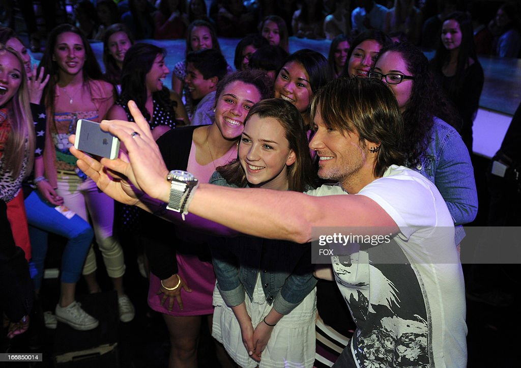 Judge Keith Urban (R) in the audience at FOX's 'American Idol' Season 12 Top 5 Live Performance Show on April 17, 2013 in Hollywood, California.