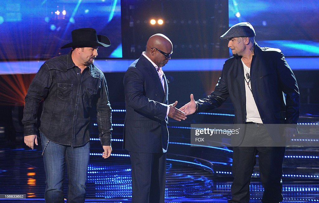 Judge L.A. Reid (C) and contestants Tate Stevens (L) and Vino Allen onstage at FOX's 'The X Factor' Season 2 Top 10 Live Performance Show on November 21, 2012 in Hollywood, California.