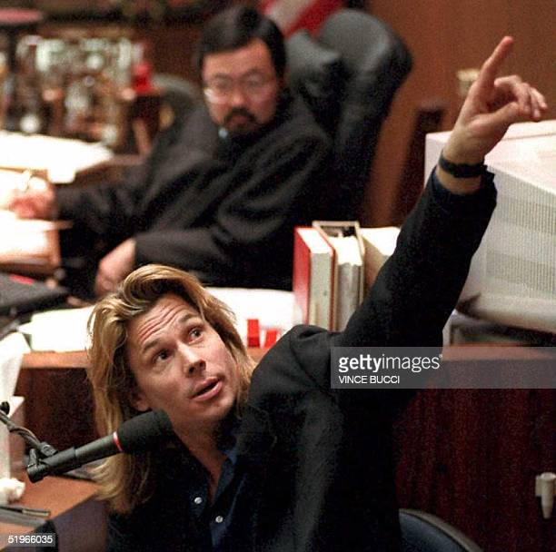 Judge Lance Ito watches as Brian 'Kato' Kaelin points to a video screen showing the path behind his bedroom where the bloody glove was found by...