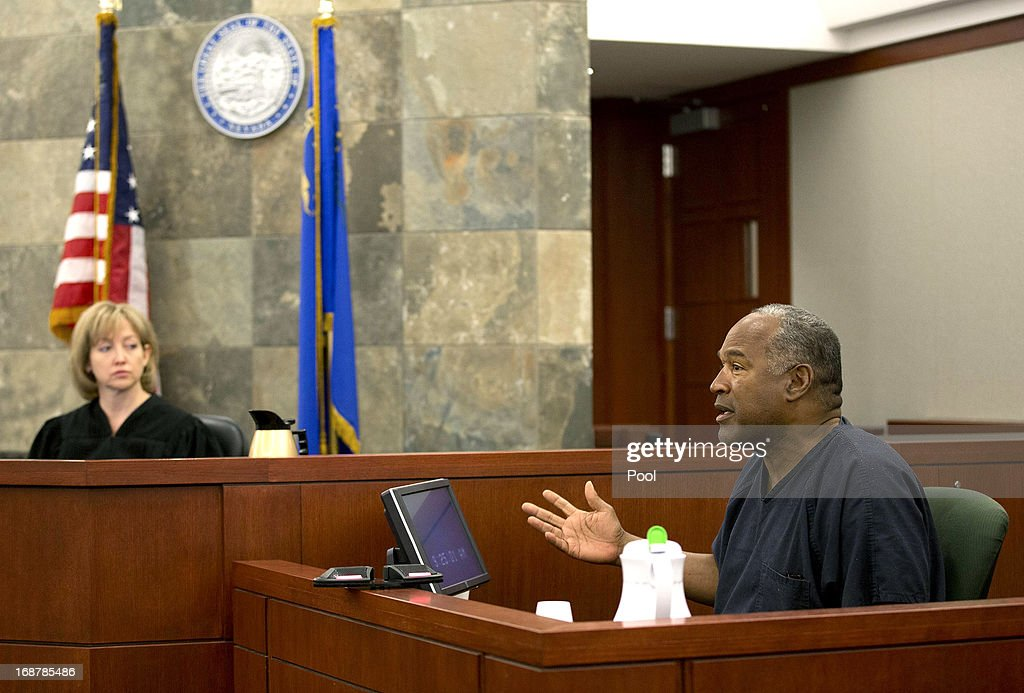 Judge Linda Marie Bell listens as <a gi-track='captionPersonalityLinkClicked' href=/galleries/search?phrase=O.J.+Simpson&family=editorial&specificpeople=123848 ng-click='$event.stopPropagation()'>O.J. Simpson</a> testifies during an evidentiary hearing in Clark County District Court May 15, 2013 in Las Vegas, Nevada. Simpson, who is currently serving a nine to 33-year sentence in state prison as a result of his October 2008 conviction for armed robbery and kidnapping charges, is using a writ of habeas corpus to seek a new trial, claiming he had such bad representation that his conviction should be reversed.
