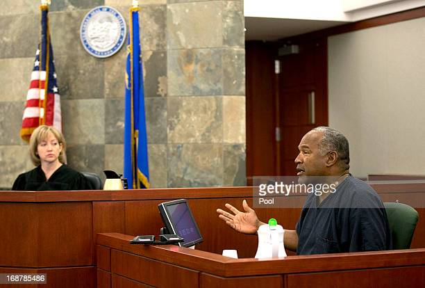 Judge Linda Marie Bell listens as OJ Simpson testifies during an evidentiary hearing in Clark County District Court May 15 2013 in Las Vegas Nevada...