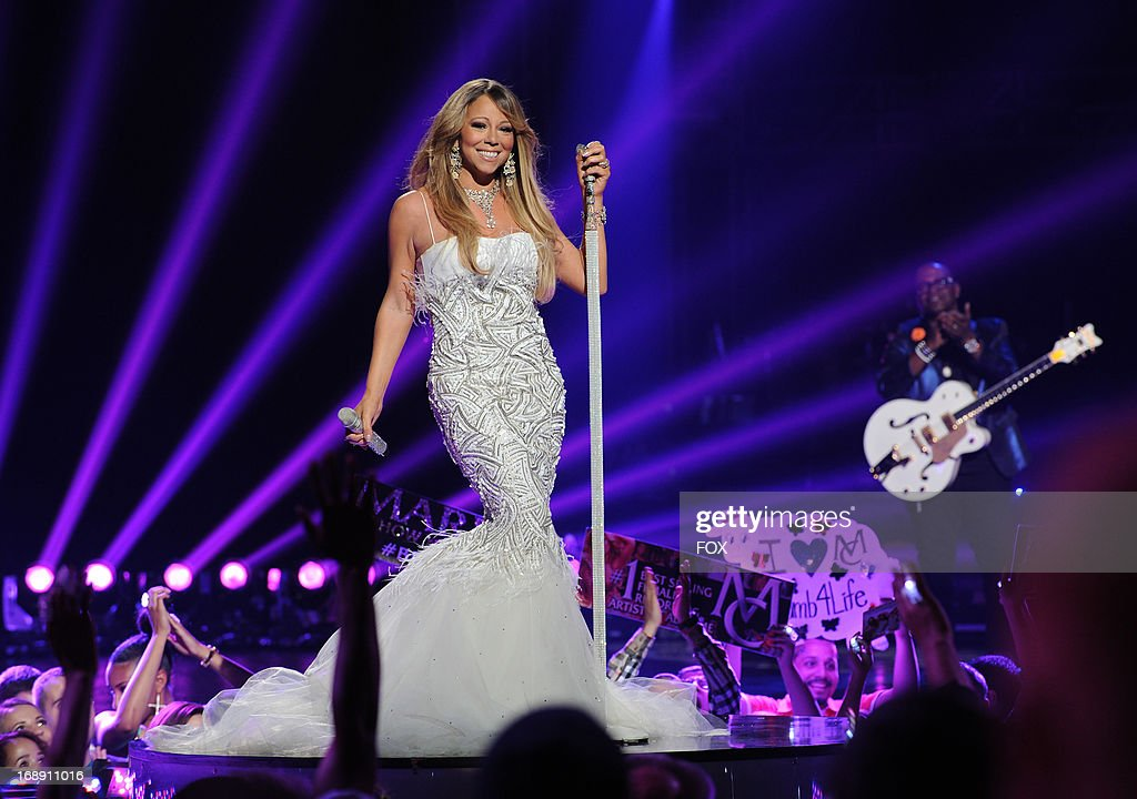 Judge <a gi-track='captionPersonalityLinkClicked' href=/galleries/search?phrase=Mariah+Carey&family=editorial&specificpeople=171647 ng-click='$event.stopPropagation()'>Mariah Carey</a> performs onstage at FOX's 'American Idol' Season 12 Live Finale Show at Nokia Theatre L.A. Live on May 16, 2013 in Los Angeles, California.