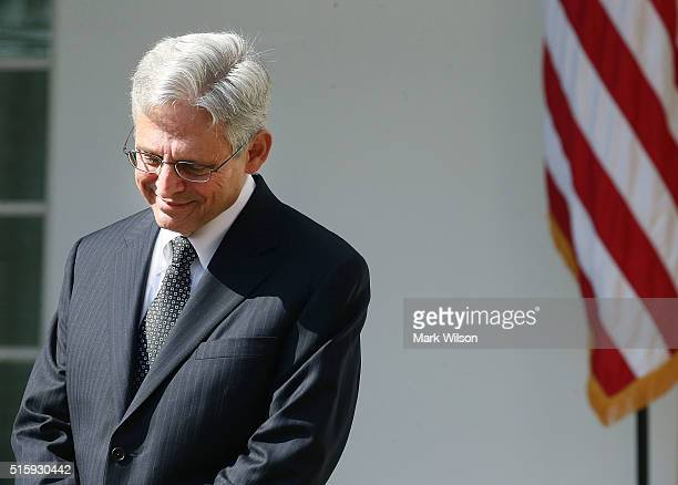 Judge Merrick B Garland listens to US President Barack Obama nominate him to the US Supreme Court in the Rose Garden at the White House March 16 2016...