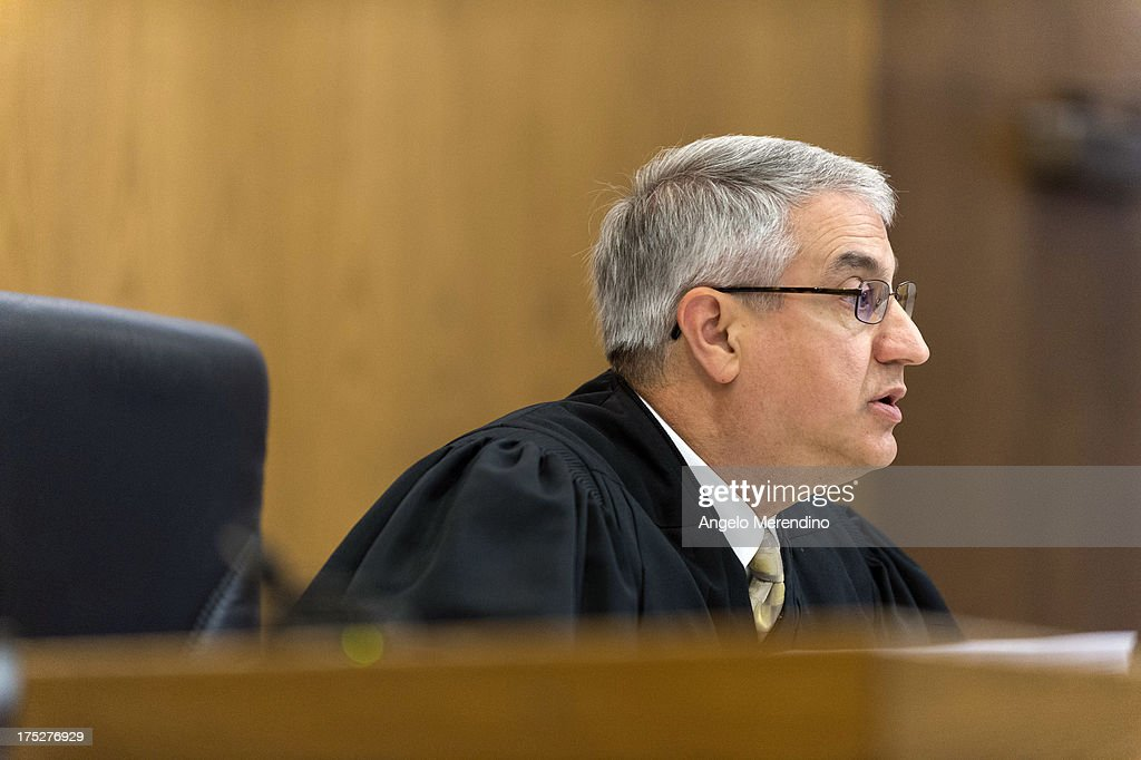 Judge Michael Russo addresses the court during the sentencing of Ariel Castro at the Cleveland Municipal Courthouse on August 1, 2013 in Cleveland, Ohio. Castro was sentenced to life without parole plus one thousand years for abducting Michelle Knight, Amanda Berry and Gina DeJesus between 2002 and 2004.