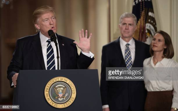 Judge Neil Gorsuch and his wife Marie Louise look on after US President Donald Trump nominated him for the Supreme Court at the White House in...