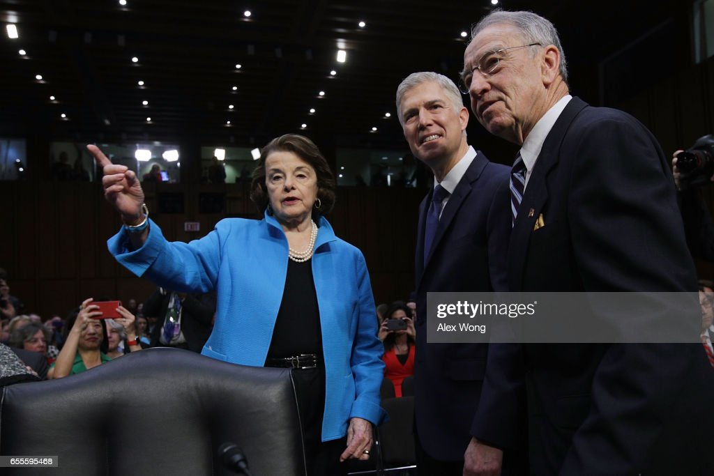 Judge Neil Gorsuch (C) arrives for the first day of his Supreme Court confirmation hearing with Senate Judiciary Committee ranking member Sen. Dianne Feinstein (D-CA) and Chairman Charles Grassley (R-IA) in the Hart Senate Office Building on Capitol Hill March 20, 2017 in Washington, DC. Gorsuch was nominated by President Donald Trump to fill the vacancy left on the court by the February 2016 death of Associate Justice Antonin Scalia.