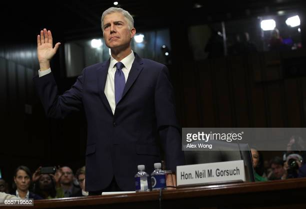 Judge Neil Gorsuch is sworn in during the first day of his Supreme Court confirmation hearing before the Senate Judiciary Committee in the Hart...