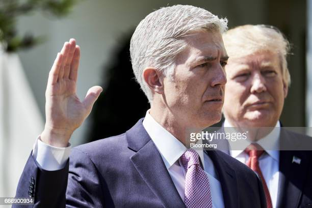 Judge Neil Gorsuch left recites the oath of office as US Donald President Trump listen during the swearing in ceremony of Gorsuch as US Supreme Court...