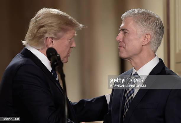 TOPSHOT Judge Neil Gorsuch speaks with US President Donald Trump after he was nominated for the Supreme Court at the White House in Washington DC on...