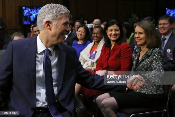 Judge Neil Gorsuch takes the hand of his wife Marie Louise Gorsuch after arriving for the first day of his Supreme Court confirmation hearing before...