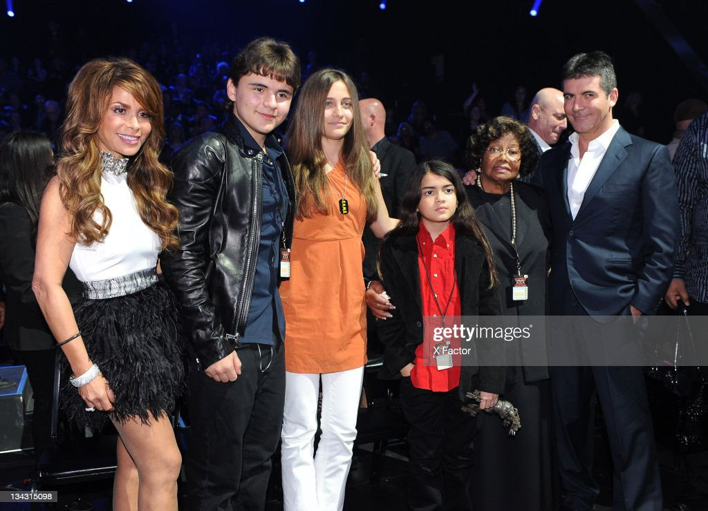 Judge <a gi-track='captionPersonalityLinkClicked' href=/galleries/search?phrase=Paula+Abdul&family=editorial&specificpeople=202119 ng-click='$event.stopPropagation()'>Paula Abdul</a> and Michael Jackson's children Prince Jackson, <a gi-track='captionPersonalityLinkClicked' href=/galleries/search?phrase=Paris+Jackson+-+Actress&family=editorial&specificpeople=2208441 ng-click='$event.stopPropagation()'>Paris Jackson</a> and Blanket Jackson, mother <a gi-track='captionPersonalityLinkClicked' href=/galleries/search?phrase=Katherine+Jackson+-+Jackson+Family&family=editorial&specificpeople=201779 ng-click='$event.stopPropagation()'>Katherine Jackson</a> and judge <a gi-track='captionPersonalityLinkClicked' href=/galleries/search?phrase=Simon+Cowell&family=editorial&specificpeople=203007 ng-click='$event.stopPropagation()'>Simon Cowell</a> in the audience at FOX's 'The X Factor' Top 7 Live Performance Show on November 30, 2011 in West Hollywood, California.