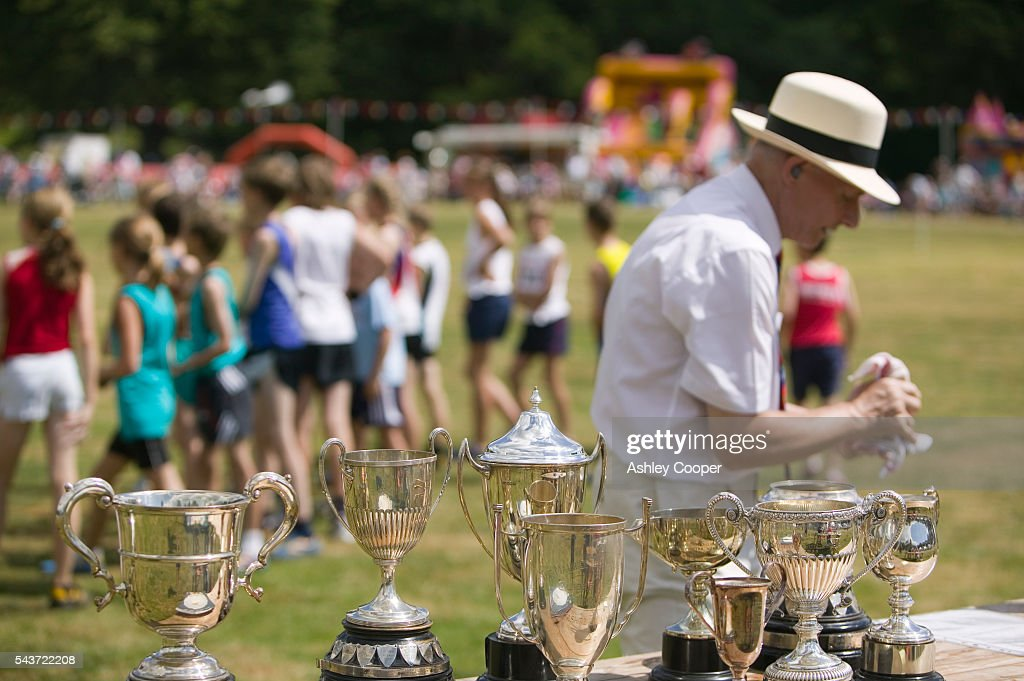 A judge polishes trophys ready for the winners during the annual Ambleside Sports competition at Rydal Park in the Lake District