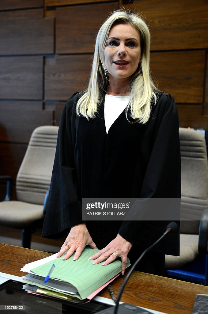 Judge Sabine Grobecker arrives at the Regional Court in Cologne, western Germany on February 27, 2013 to preside the Sal Oppenheimer trial for alleged embezzlement in one of the biggest cases dealing with corporate crime in recent years. AFP PHOTO / PATRIK STOLLARZ