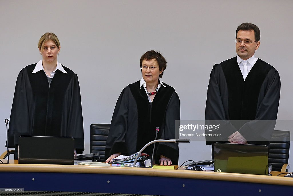 Judge Sabine Roggenbrod (C) looks on prior to the trial of accused Russian spies with the aliases Andreas and Heidrun Anschlag on the first day of their trial on January 15, 2013 in Stuttgart, Germany. The couple came to Germany in 1988, reportedly as KGB spies, and continued operating for the modern Russian intelligence service while maintaining a front as immigrants from South America until their arrest in late 2011 by German police. Among the couple's biggest coups was recruiting Dutch Foreign Ministry worker Raymond Valentino Poeteray, who sold them top secret NATO documents. The couple also had a daughter while living in Germany who is now in her early 20s and reportedly knew nothing of her parents' true identity and espionage activities. German law enforcement authorities came onto the Anschlags' trail following the arrests last year of 10 Russian spies in the United States.