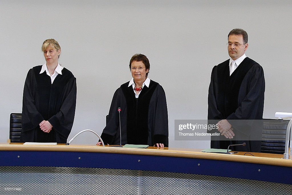 Judge Sabine Roggenbrod (C) looks on prior to the trial of accused Russian spies with the aliases Andreas and Heidrun Anschlag in court on the last day of their trial on July 2, 2013 in Stuttgart, Germany. The couple came to Germany in 1988, reportedly as KGB spies, and continued operating for the modern Russian intelligence service while maintaining a front as immigrants from South America until their arrest in late 2011 by German police. Among the couple's biggest coups was recruiting Dutch Foreign Ministry worker Raymond Valentino Poeteray, who sold them top secret NATO documents. The couple also had a daughter while living in Germany who is now in her early 20's and reportedly knew nothing of her parents' true identity and espionage activities. German law enforcement authorities came onto the Anschlags' trail following the arrests last year of 10 Russian spies in the United States.