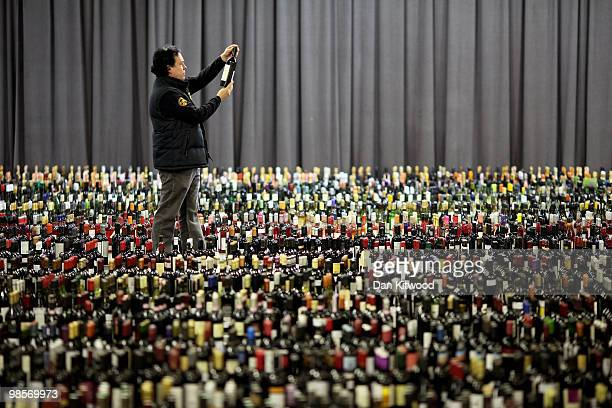 A judge selects a bottle of wine for tasting during the 'International Wine Challenge' event at the Barbican centre on April 20 2010 in London...
