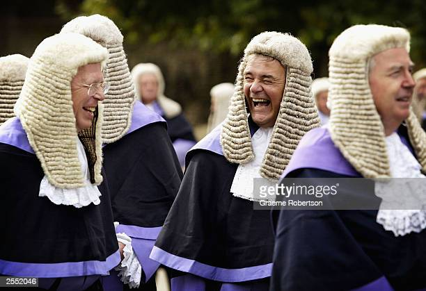 A judge shares a joke with a colleague October 1 2003 London English judges dress up in full legal regalia arriving at Westminster Abbey from the...
