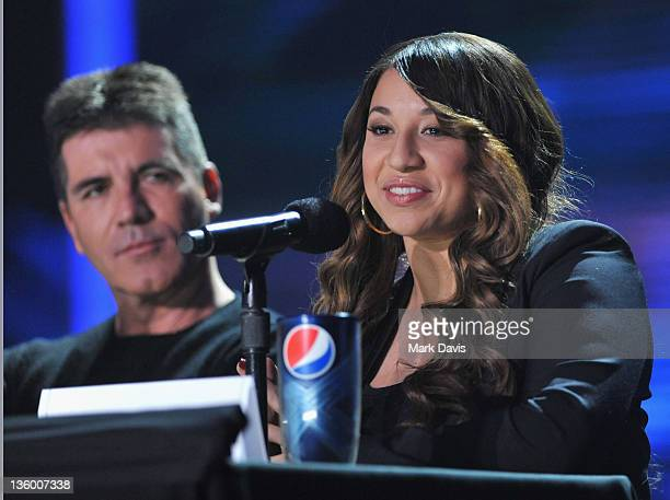 Judge Simon Cowell and contestant Melanie Amaro attend The X Factor Press Conference at CBS Television City on December 19 2011 in Los Angeles...