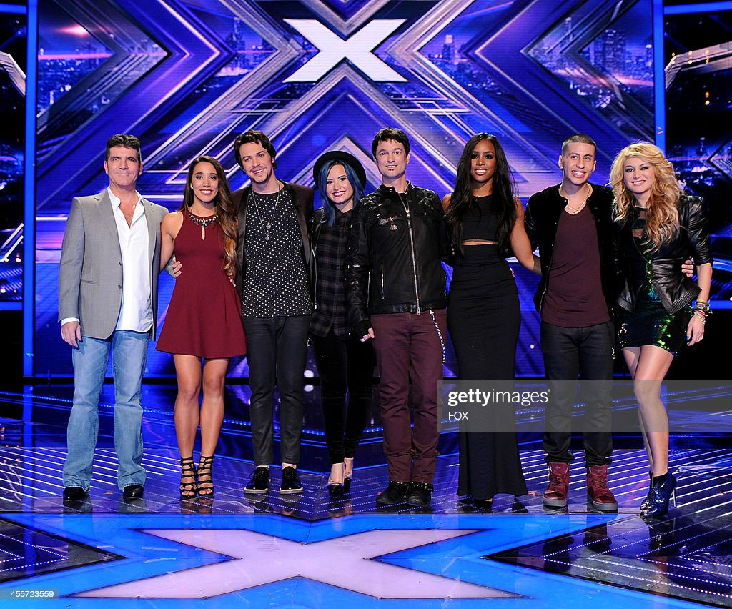 Judge Simon Cowell, finalists Alex & Sierra, judge Demi Lovato, finalist Jeff Gutt, judge Kelly Rowland, finalist Carlito Olivero and judge paulina Rubio onstage on FOX's 'The X Factor' Season 3 Top 4 To 3 Live Elimination Show on December 12, 2013 in Hollywood, California.