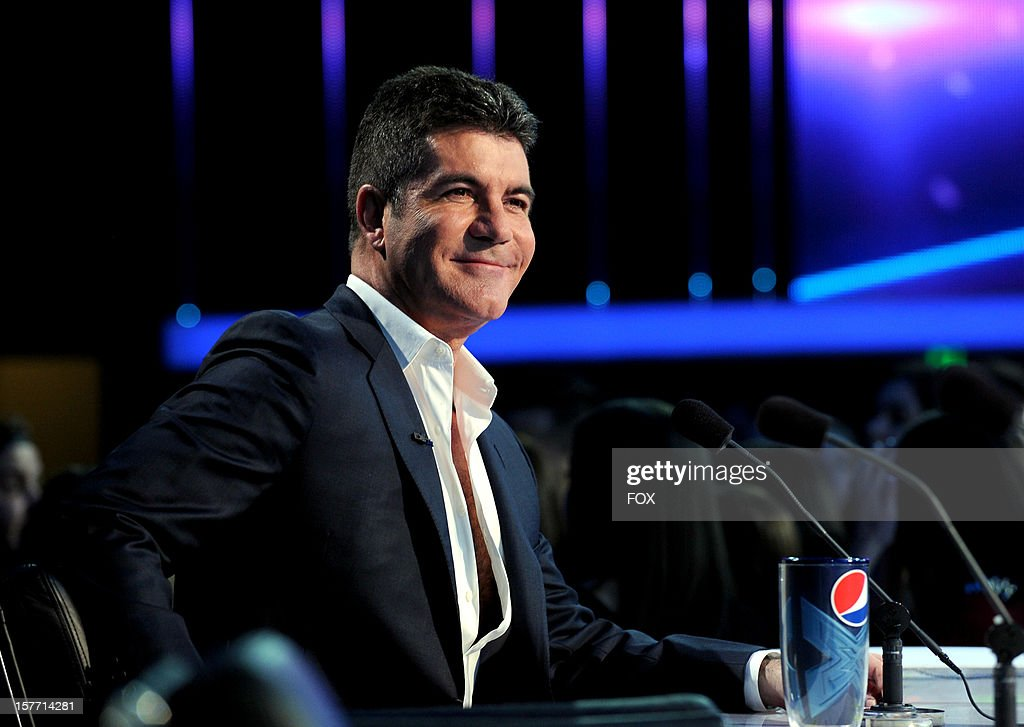 Judge Simon Cowell onstage at FOX's 'The X Factor' Season 2 Top 6 Live Performance Show on December 5, 2012 in Hollywood, California.