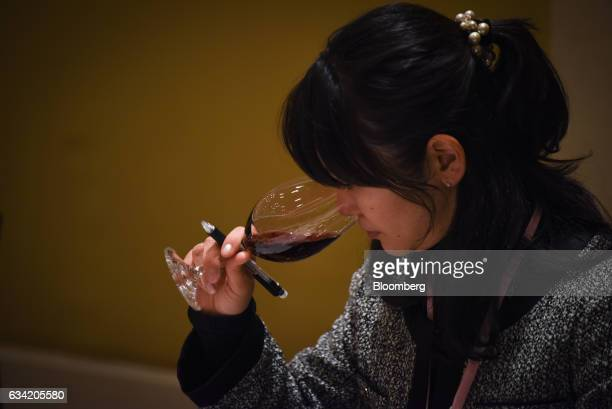 A judge smells a glass of wine at the 4th Sakura Japan Women's Wine Awards 2017 the international wine competition judged by female wine...