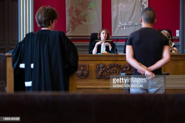 A judge speaks to a youth during a hearing at the children's court in Mulhouse on June 26 2013 S COURTS