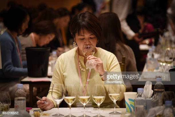 A judge tastes a glass of wine at the 4th Sakura Japan Women's Wine Awards 2017 the international wine competition judged by female wine...