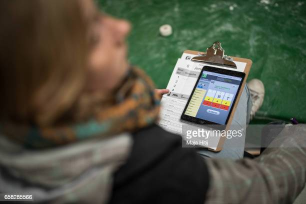 A judge watches Semi Finals of bouldering event Studio Bloc Masters 2017 on March 26 2017 in Pfungstadt Germany