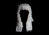 Judge white wig on a black background.