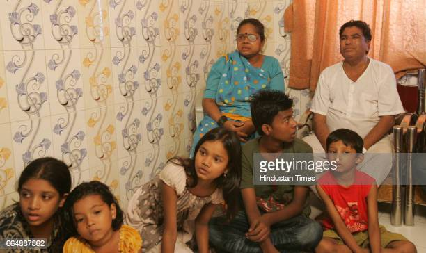 Judgement Family members of Thakur Waghela and Mukesh Jadhav watching TV reacts after Kasab was sentenced to death by a special court on Thursday at...
