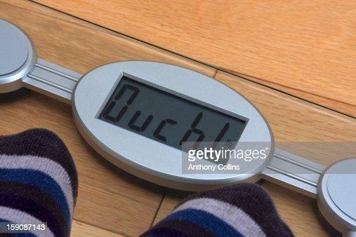 Judgemental bathroom scales : Stock Photo