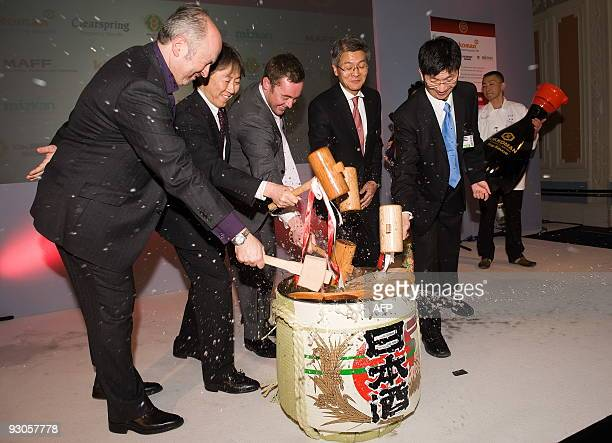 Judges and dignitaries perform the traditional 'breaking of the sake barrel' after naming Tomoyuki Abe from 'Sushizen' in Japan as the winner of the...