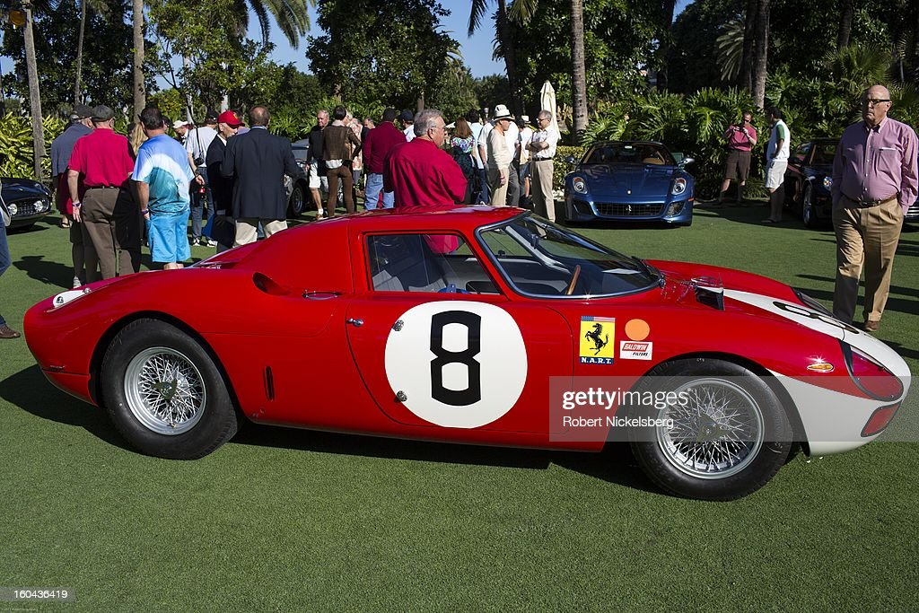 Judges and spectators inspect a 1964 250 LM antique Ferrari automobile at the annual Cavallino Auto Competition, January 26, 2013 held at The Breakers Hotel in Palm Beach, Florida.