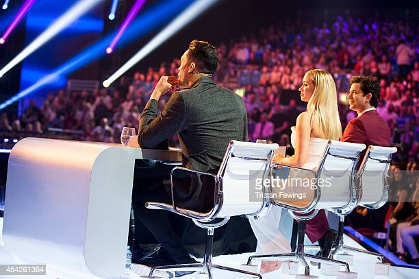 Judges Ashley Banjo Kimberley Wyatt and Adam Garcia on stage during the third live show of 2014's 'Got To Dance' at Earls Court on August 27 2014 in...