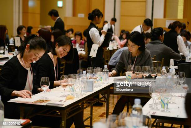 Judges assess glasses of wine at the 4th Sakura Japan Women's Wine Awards 2017 the international wine competition judged by female wine professionals...