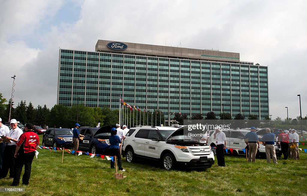 Judges assess the repairs made on Ford Motor Co. Explorers by students from across the nation at the National Finals of the Annual Ford/AAA Student Auto Skills Competition at the Ford World Headquarters in Dearborn, Michigan, U.S., on Tuesday, June 11, 2013. Job openings in the U.S. fell in April, showing companies were waiting to assess the effects of higher taxes and reduced government spending before committing to bigger staff increases. Photographer: Ty Wright/Bloomberg via Getty Images
