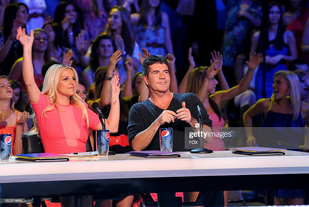FACTOR Judges Britney Spears and Simon Cowell at THE X FACTOR airing Wednesday Sep 19 2012 on FOX