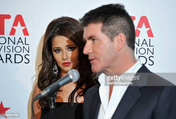 Judges Cheryl Cole and Simon Cowell speak after they win the Most Popular Talent Show for The X Factor during the National Television Awards at the...