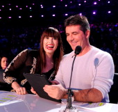 Judges Demi Lovato and Simon Cowell on FOX's 'The X Factor' Season 2 Live Performance Show on October 31 2012 in Hollywood California