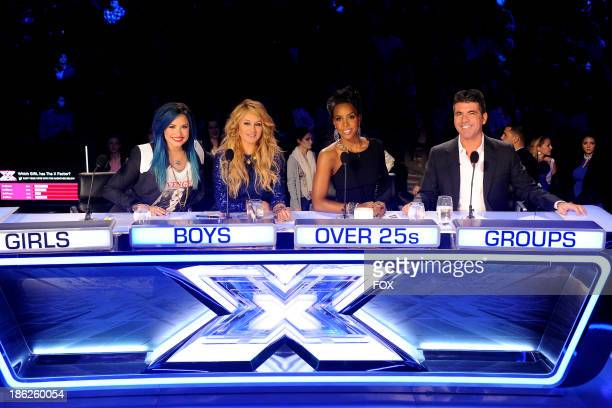 Judges Demi Lovato Paulina Rubio Kelly Rowland and Simon Cowell on FOX's 'The X Factor' Season 3 Top 16 Live Performance Show on October 29 2013 in...
