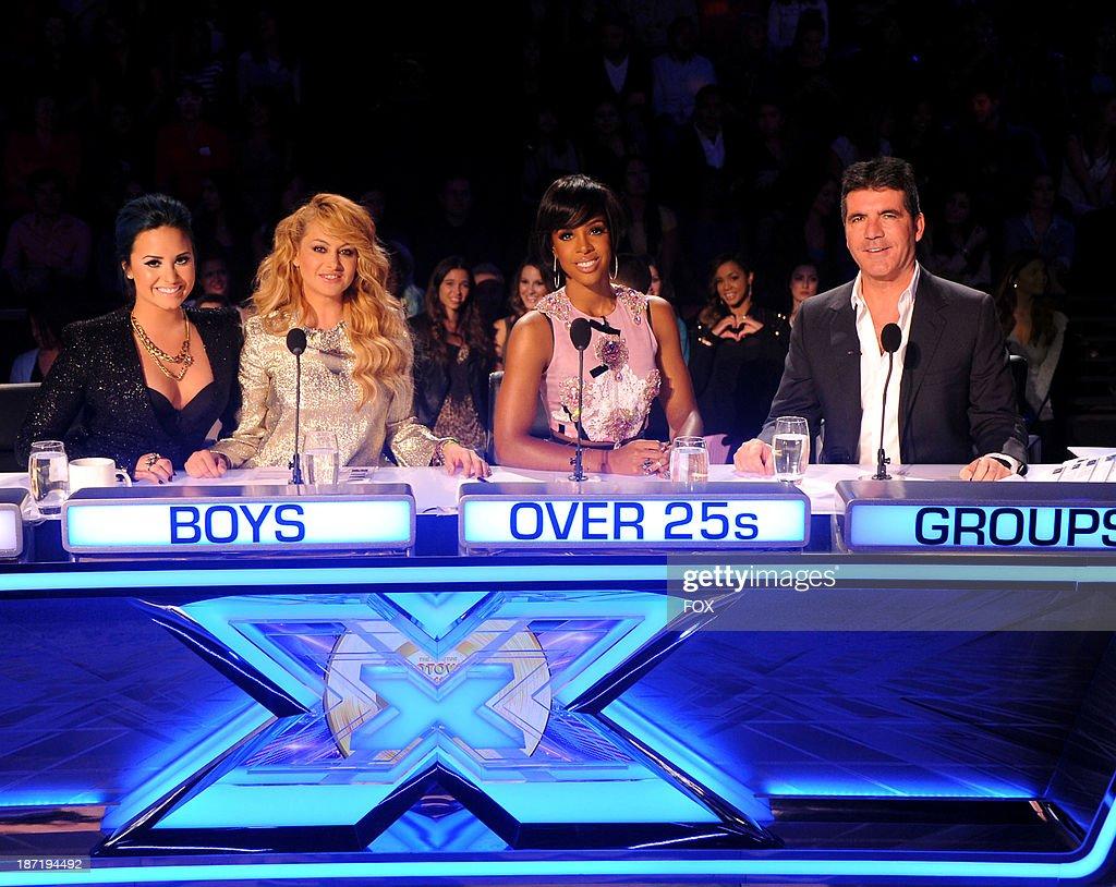 Judges Demi Lovato Paulina Rubio Kelly Rowland and Simon Cowell on FOX's 'The X Factor' Season 3 Top 13 Live Performance Show on November 6 2013 in...