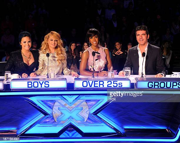 Judges Demi Lovato Paulina Rubio Kelly Rowland and Simon Cowell on FOX's 'The X Factor' Season 3 Top 13 Live Performance Show on November 6 2013 in...