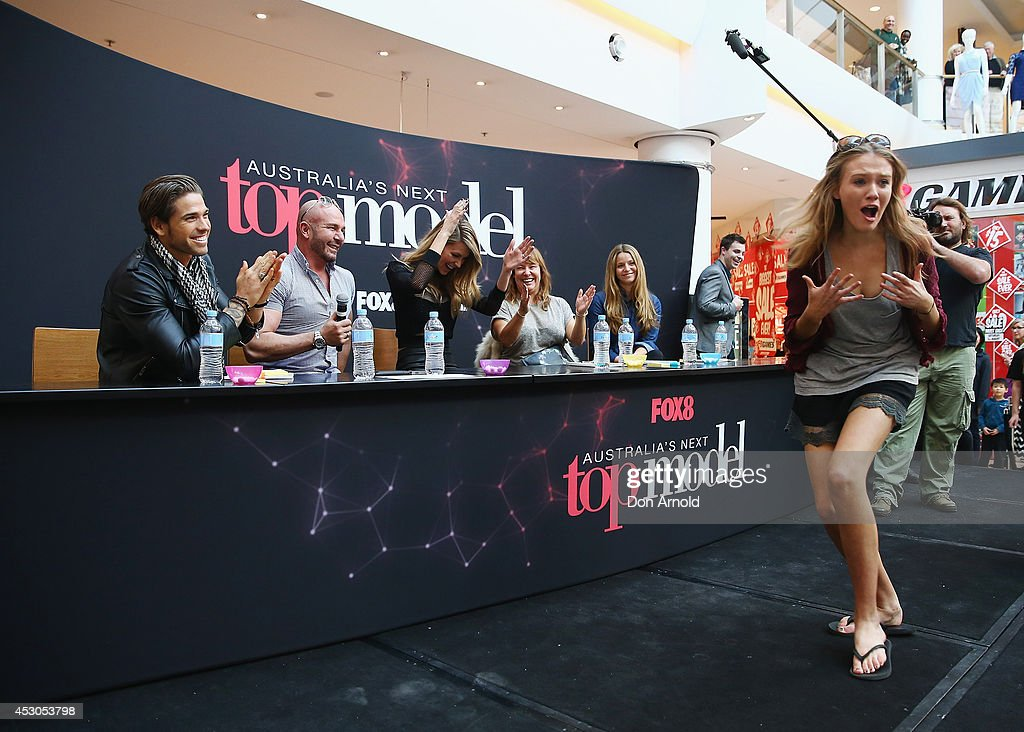 Judges Didier Cohen, Alex Perry and Jennifer Hawkins look on as a contestant reacts to her shock at getting through to the second at Australia's Next Top Model auditions at Chatswood Chase Shopping Centre on August 2, 2014 in Sydney, Australia.