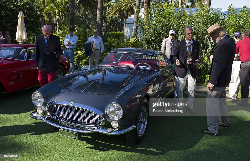 Judges discuss the quality of a 1955 250 GT TDF Speciale antique Ferrari automobile at the annual Cavallino Auto Competition, January 26, 2013 held at The Breakers Hotel in Palm Beach, Florida.