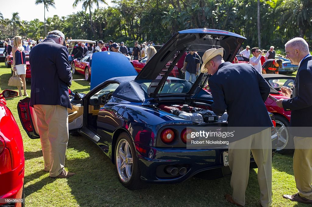Judges discuss the quality of a 2003 Ferrari Enzo automobile at the annual Cavallino Auto Competition, January 26, 2013 held at The Breakers Hotel in Palm Beach, Florida.