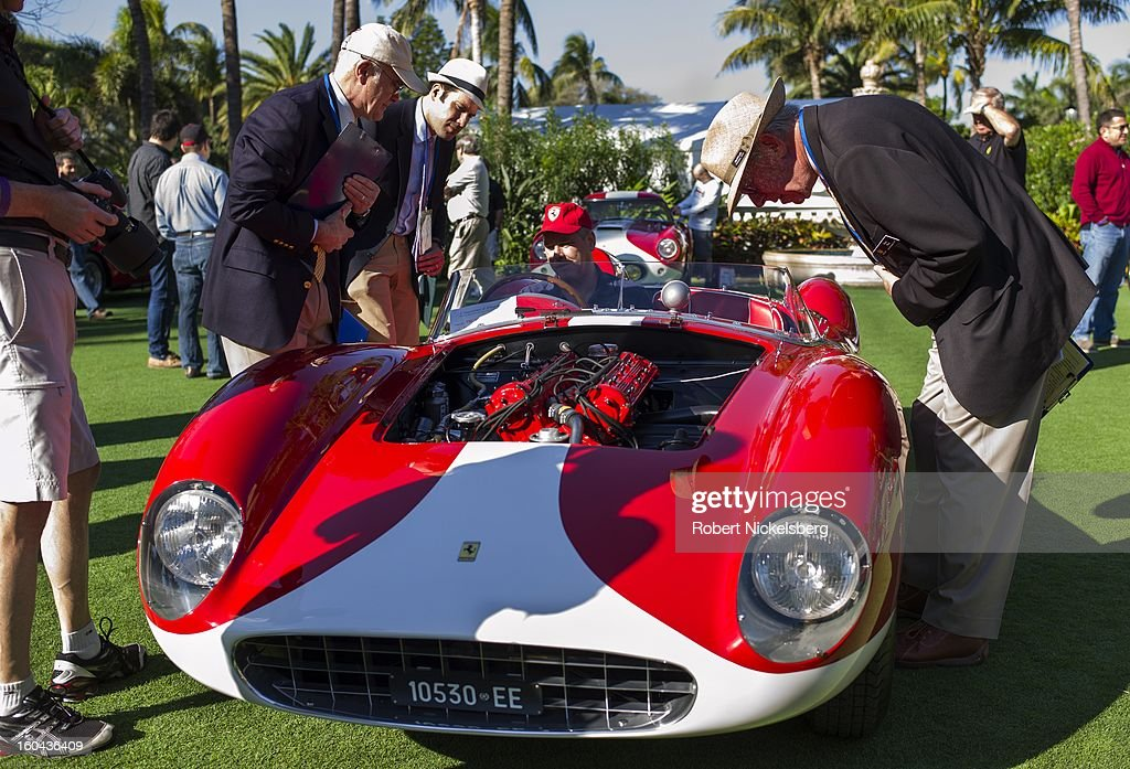 Judges discuss the quality of antique Ferrari automobiles at the annual Cavallino Auto Competition, January 26, 2013 held at The Breakers Hotel in Palm Beach, Florida.